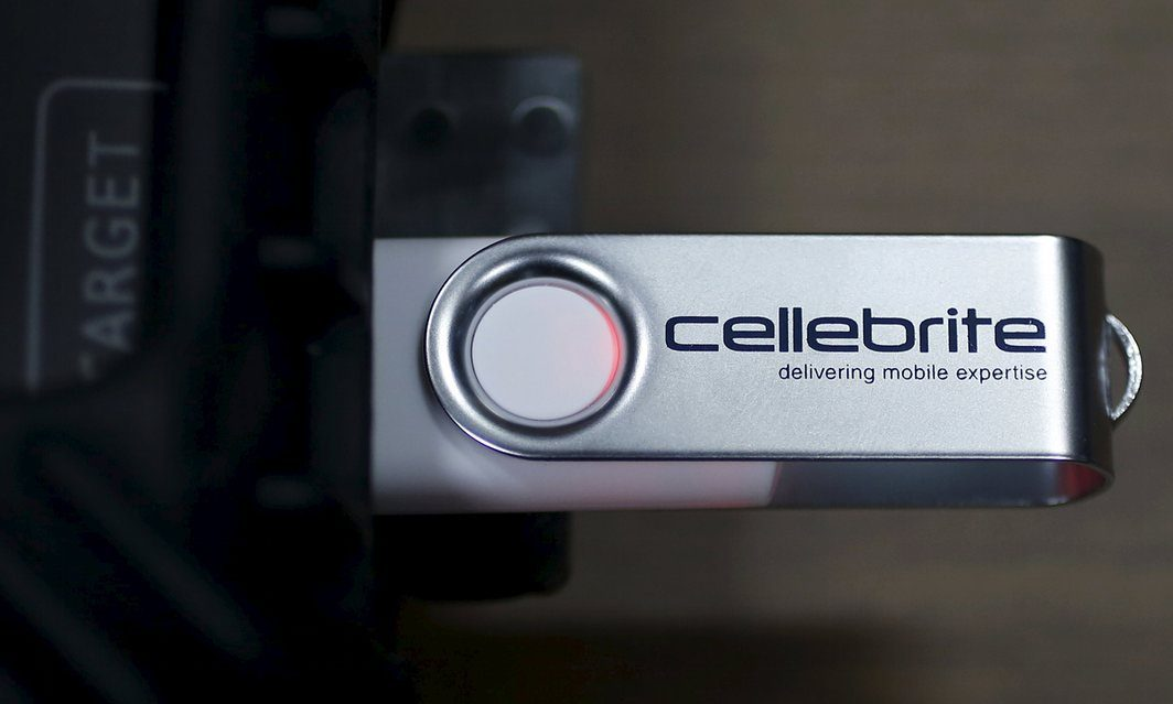 A USB device is attached to Cellebrite UFED Touch, a device for the data extraction from a mobile device such as mobile phone or smartphone. Photograph: Issei Kato/Reuters